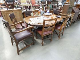 5207 Set of 7 carved oak dining chairs with embossed leather backs (6+1)