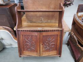 Oak wall mounted cabinet with floral panels