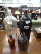 2 poison bottles and 2 other glass bottles