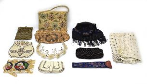 A group of textiles including an embroidered clutch bag with glass roundels,