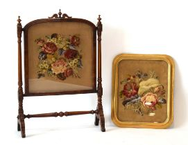 A 19th century mahogany fire screen with a bead and stumpwork panel,