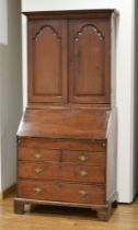 A Georgian mahogany bureau bookcase, the two doors enclosing a stationary cupboard,
