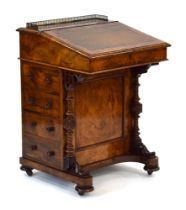 A Victorian figured walnut davenport, the gallery enclosing a letter rack,