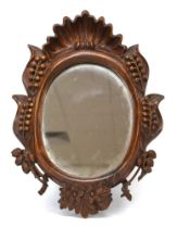 A Continental carved wall mirror,