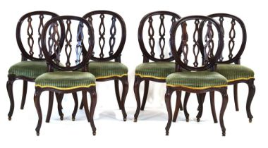 A set of six 19th century mahogany dining chairs, the hoop backs with decorative splats,