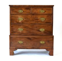 A 19th century mahogany and crossbanded chest-on-chest of low proportions,