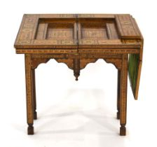 An early 20th century Moorish style marquetry and mother-of-pearl games table,