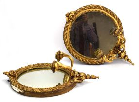 A pair of late 19th century Girondelle-type gilt wall mirrors of circular form,