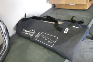 2 packed camping beds