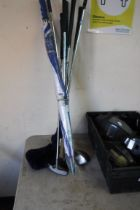Selection of golf clubs and golf umbrella