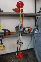 Combination garden strimmer, hedge trimmer and chainsaw attachment