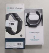 FitBit Charge 3 fitness activity tracker with charger and box