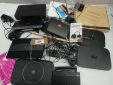 Bag containing Ring base station, routers, laptop stand, game controller converter, etc