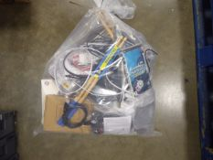 Bag containing remote control car, cables, gaming mouse pad, aerial, etc