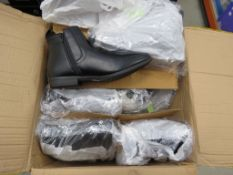 Box containing pairs of mens black boots in various sizes