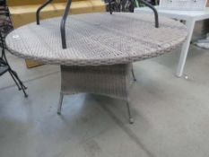 Circular rattan garden table in grey