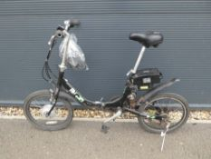 Folding Motion electric bike in black with charger