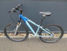 Trex mountain bike in pale blue/ dark blue