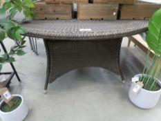 Circular rattan garden table in brown on matching base