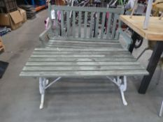 Slatted wood garden bench in green with matching table