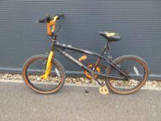 Muddy Fox BMX bike in black and orange