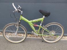 Apollo Guru full suspension mountain bike in green