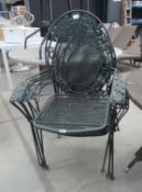 4 bent metal stacking garden chairs in green