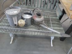 3 galvanized watering cans and galvanized tray