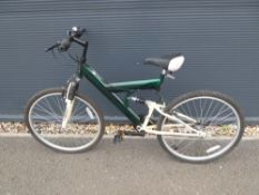 Full suspension mountain bike in green and cream