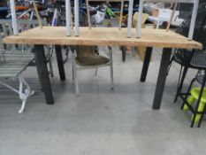 Large waney edge top oak garden table on black supports