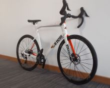 Cinelli Pressure road bike in white and orange apparently unused with wiggle wheel carrier