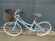 Light blue girls Amacco cycle with front basket