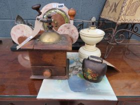 2 Coffee grinders, an ornamental cow bell plus a small oil on card still life with flowers