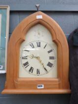 Quartz wall clock in pine frame