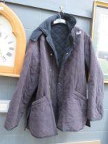 Diamond stitched blue Barbour coat