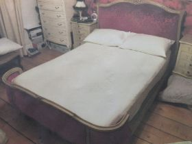 French style sleigh bed with red upholstery