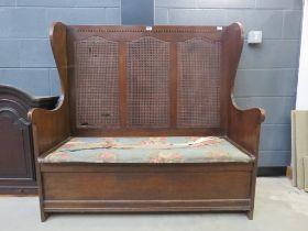 Oak upholstered settle