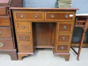 Mahogany and cross banded knee hole desk