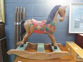 Poly-chrome rocking horse