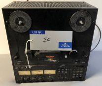 A Fostex E-2 Reel to Reel Tape Recorder (powers up).