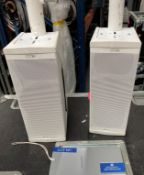 A Pair of NEXO ID24 Speakers in white fitted with pole mount and mobile flight case (in working