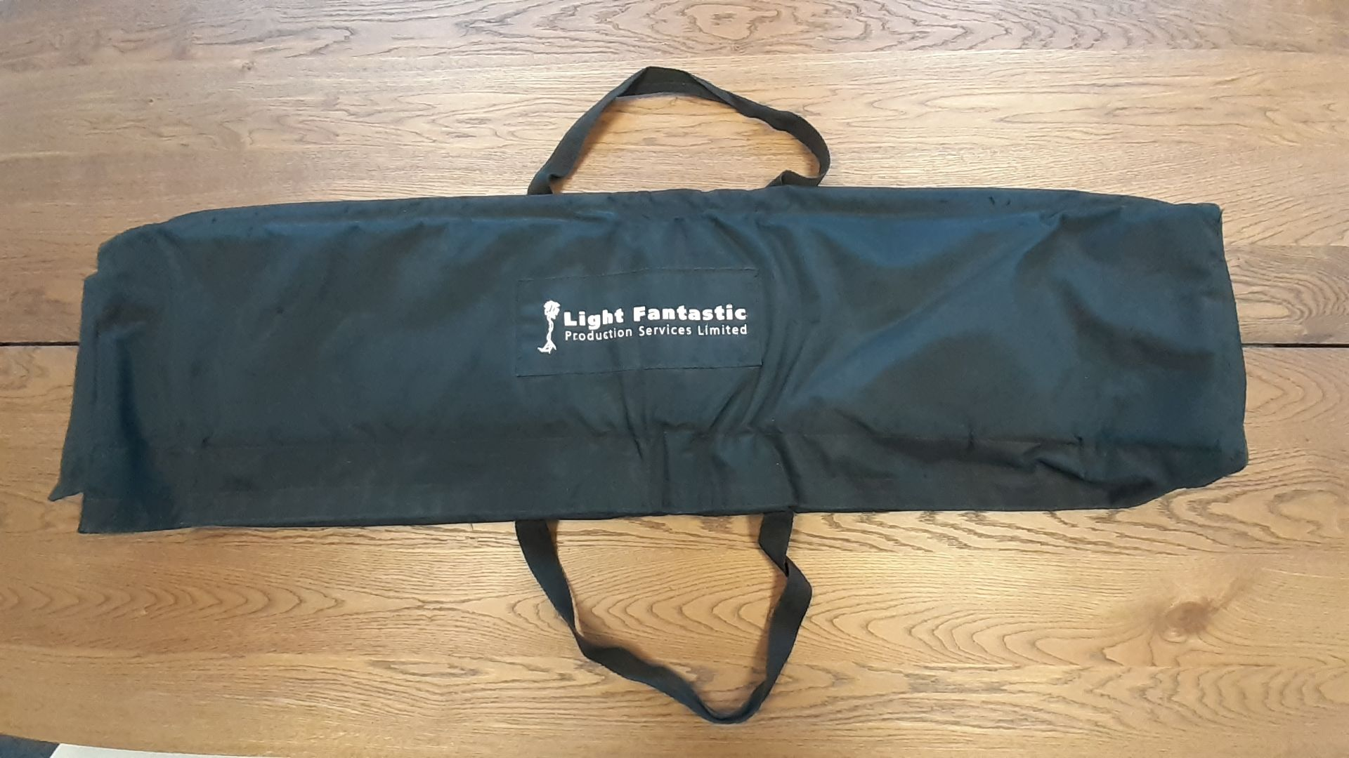 8 x Padded Speaker Stand Bags with velcro closures, branded 'Light Fantastic Production Services',