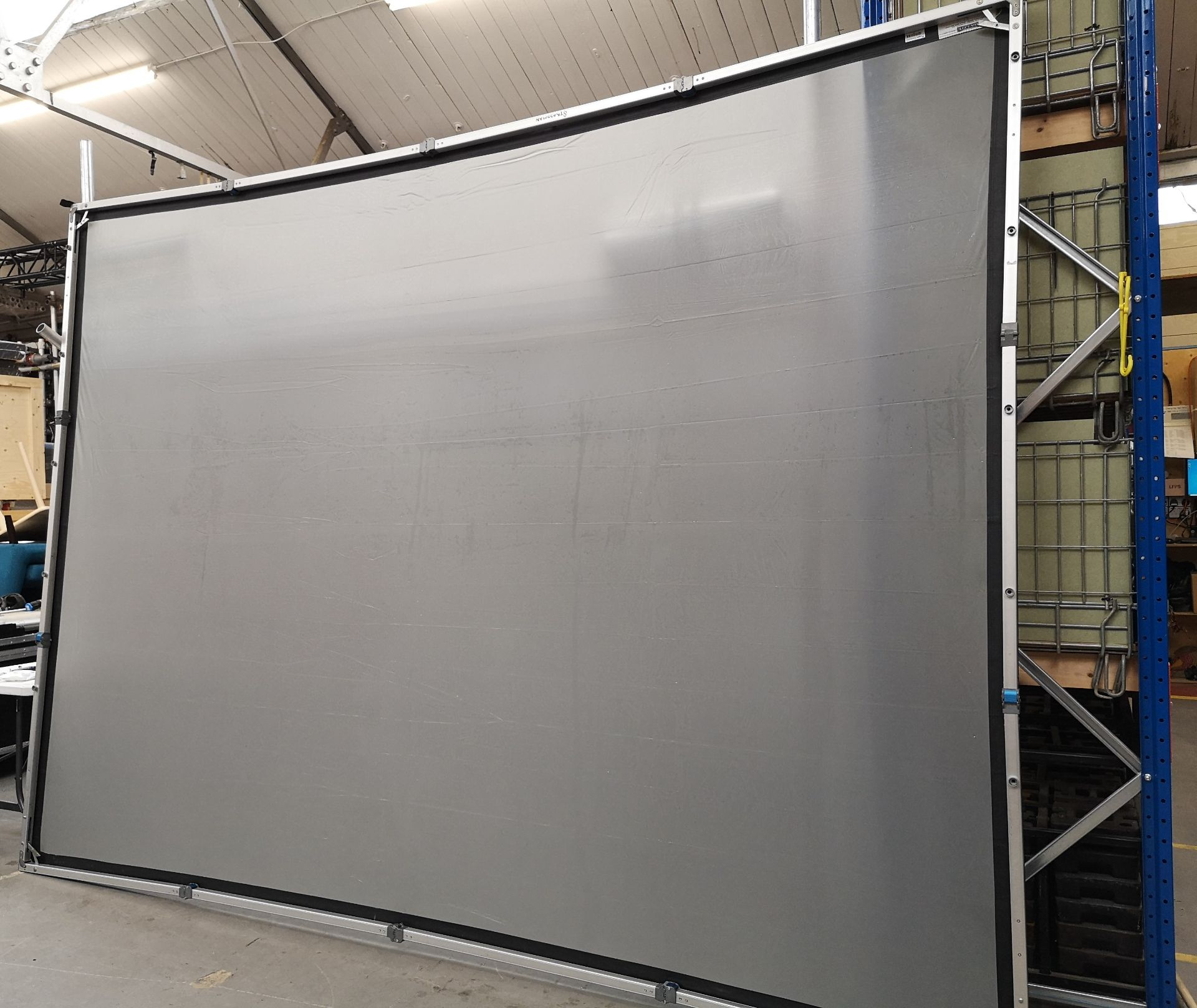 A DA-LITE 12ft x 9ft Rear Projection Fastfold Screen with frame, legs, bolts, screen surface, bag