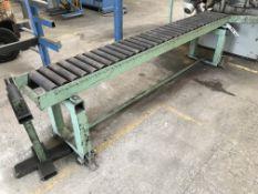 A Heavy Duty Roller Feed Conveyor, 12in x 96in.