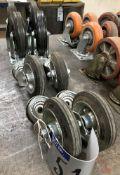 2 Sets of 4 Castors: 1-200mm dia x 50mm w, 2 braked, black; 1-150mm dia x 40mm w, black.