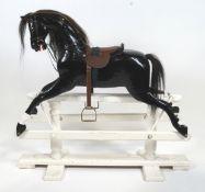 Edwardian black painted wooden rocking horse