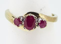 9ct (375) Yellow Gold Oval & Round Three Stone Ruby Crossover Ring