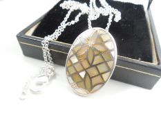 Silver necklace with mother of pearl pendant.