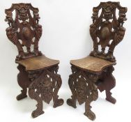 Pair of antique Italian walnut scabello chairs