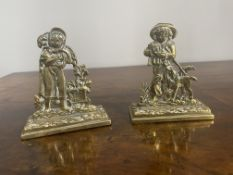 Pair of brass ornaments